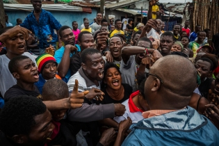 4. Aug. 25, 2014.  Residents of the West Point slum in Monrovia complain about the lack of necessities to a government official after the neighborhood was quarantined, a closure that set off deadly riots. Daniel Berehulak documented the chaotic period before the epidemic drew the world's attention.